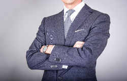 Smart klädde mannen i dräkt Arkivbild