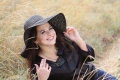 Smart lady  in  black bonnet Stock Image