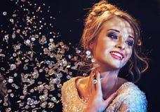 Smart lady likes luxury crystals Stock Photos