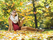 Smart lady watching autumn leaves Stock Photography