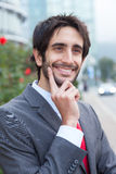 Smart latin businessman with beard in front of his office Royalty Free Stock Images