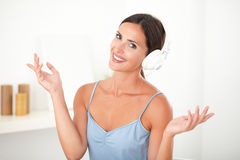 Smart latin woman with headphones looking relaxed Royalty Free Stock Image
