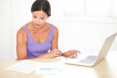 Smart latin woman studying on the computer Stock Image