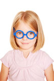 Smart little blue-eyed girl with glasses. Royalty Free Stock Photos