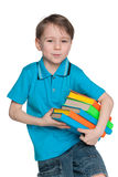 Smart little boy with books Royalty Free Stock Photos