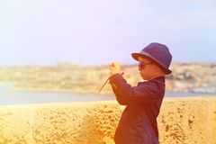 Smart little boy taking photos while travel in Royalty Free Stock Photos