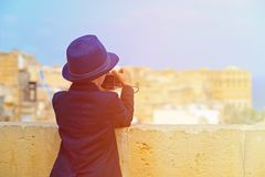 Smart little boy taking photos while travel in Royalty Free Stock Images