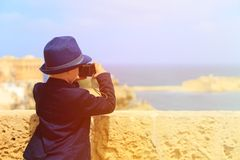 Smart little boy taking photos while travel in Stock Photos