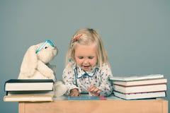Smart little girl Stock Image