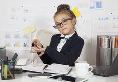 Smart little girl doing manicure Stock Image