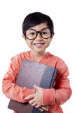 Smart little girl with glasses and book Royalty Free Stock Photos