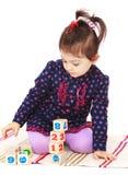 Smart little girl in a Montessori kindergarten is Stock Images