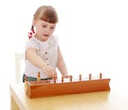 Smart little girl in a Montessori kindergarten Royalty Free Stock Image