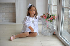 Smart little girl in white dress Royalty Free Stock Photo