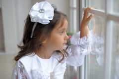Smart little girl in white dress Stock Photos