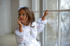 Smart little girl in white dress Royalty Free Stock Photography