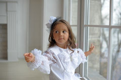 Smart little girl in white dress Stock Photography