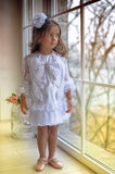 Smart little girl in white dress Royalty Free Stock Photos