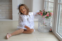 Smart little girl in white dress Stock Images
