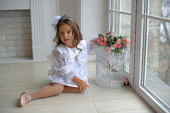 Smart little girl in white dress Stock Photo