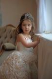 Smart little girl in white dress Stock Photography