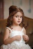 Smart little girl in white dress Royalty Free Stock Photos