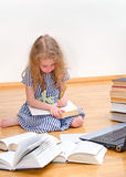 Smart little girl writes diploma. royalty free stock photo