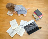 Smart little girl writes diploma at home. stock images
