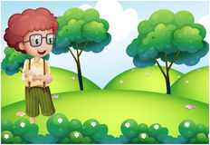 A smart looking boy standing at the top of the hill. Illustration of a smart looking boy standing at the top of the hill Stock Photos