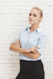 Smart looking businesswoman with armcrossed Royalty Free Stock Photos