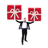 Smart Looking Man Holding Two Huge Red Gift Boxes Stock Image