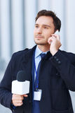 Smart-looking man is talking over the phone Royalty Free Stock Photos