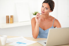 Smart lovely woman studying in her room Royalty Free Stock Images