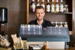 Smart Male Bartender At Counter In Cafe Royalty Free Stock Images