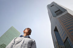 Smart Male Executive With High Structure Buildings Royalty Free Stock Photography