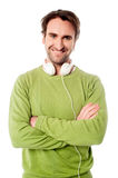 Smart male with headphones around his neck Royalty Free Stock Photos
