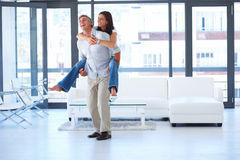 Smart male piggybacking his wife Royalty Free Stock Photography
