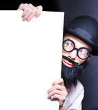 Smart Male Science Professor With Blank Board. Humorous Image Of A Stereotypical Bearded Professor Wearing Glasses And A Hat Peering Inquisitively Around A Blank Stock Images