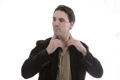 Smart man adjusting collar Stock Photo