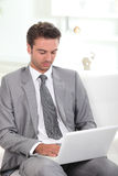 Smart man browsing the Internet Stock Photography
