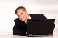 Smart man at computer Royalty Free Stock Image