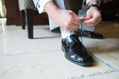 Smart man fastening shoelace Royalty Free Stock Photo