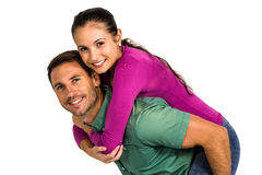 Smart man giving piggy back to his girlfriend Royalty Free Stock Images