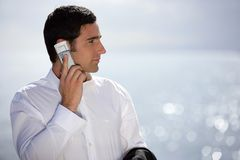 Smart man having phone call outdoors Stock Image