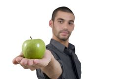 Smart man offering apple Royalty Free Stock Photo