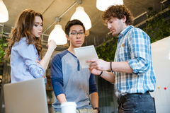 Smart  man sharing his ideas with concentrated coworkers Stock Images