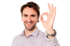 Smart man showing okay sign Stock Images