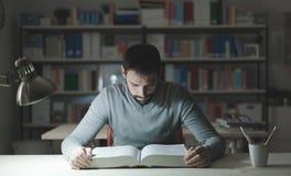 Smart man studying at night Royalty Free Stock Image