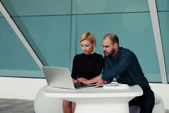 Smart man and woman reading information on net-book about the results of their work Royalty Free Stock Images