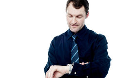 Smart manager checking time on his watch Stock Photography